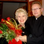 Dr. Jack presenting roses following Kitty's speaking event at Catholic Church in Radom, October 13, 2009