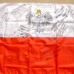 Official flag of Poland, signed by various hosts, inc. radio, magazine, & newspaper reps